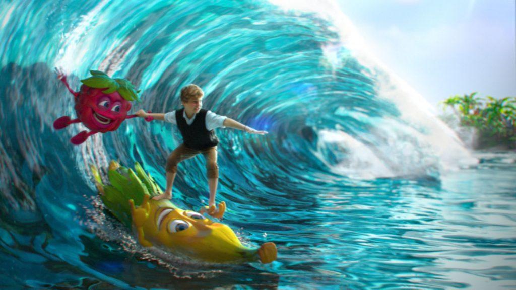 Boy surfing a huge tropical wave on a Mamba banana cartoon character
