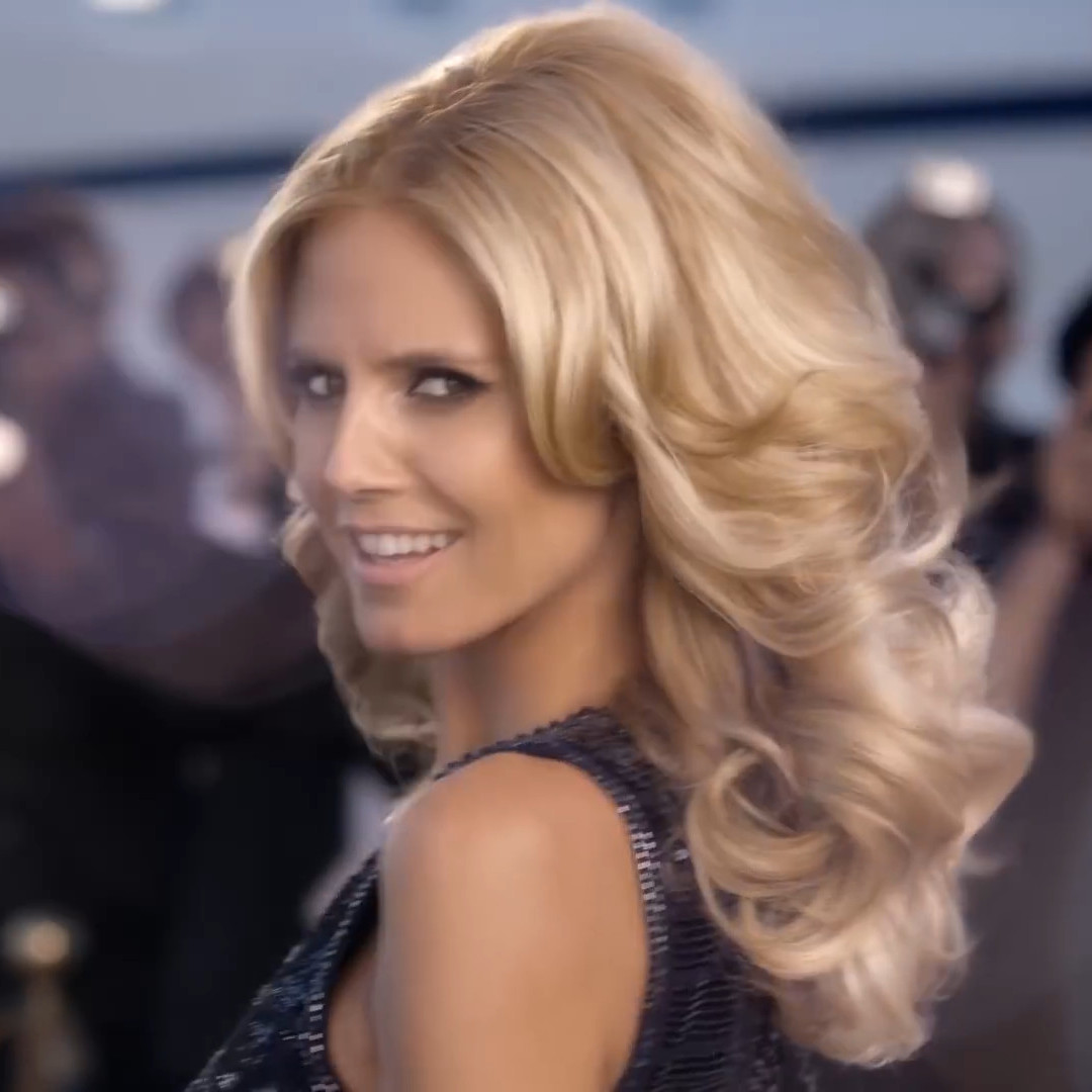 Closeup of Heidi Klumm smiling and showing her wonderfull blond hair in her Schwarzkopf Drei Wetter Taft Ultimate commercial.